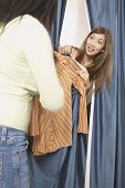 picture of pacific islander ethnicity  - Asian woman peeking out from dressing room - JPG