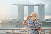 Young Woman Traveling With Hat In The Morning, Happy Asian Traveler Visit In Singapore City Downtown poster