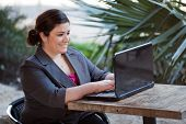 Businesswoman - Telecommuting From Internet Cafe