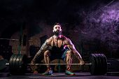 Muscular Fitness Man Doing Deadlift Of A Barbell In Modern Fitness Center In Smoke. Functional Train poster