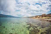 Sea Coast Of A Small Croatian City. Clear Water Of The Adriatic Sea. Sights Of European Cities. poster