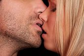 stock photo of tease  - love kiss of young sexy heterosexual sensual couple - JPG