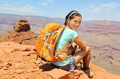 Grand Canyon hiker woman resting portrait. Hiking multiethnic girl relaxing on South Kaibab Trail, s