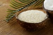 stock photo of ground nut  - grounded coconut flakes  - JPG