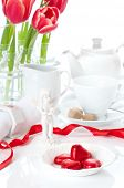 Heart shaped chocolates for Valentines day in a romantic teatime setting poster
