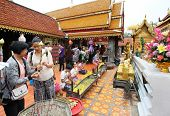 CHIANGMAI - NOVEMBER 30: Locals and tourists come to pray at the Doi Suthep Temple in Chiang Mai, Thailand on November 30, 2012. The temple founded in 1385 is a major tourist attraction in Chiang Mai.