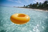 floating ring on blue clear sea with beach, shallow dof