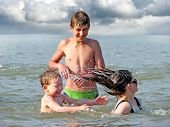 pic of children beach  - happy children play and bathing in the sea - JPG