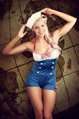 Sailor Pinup Girl On Vintage Travel Map Background
