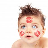 Image of lovely Cupid boy with red lipstick stamp on his cheeks and forehead isolated on white background, Valentines day, romantic holiday, beautiful blue eyes, love and care concept