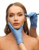 pic of scalpels  - picture of woman face and beautician hands with scalpel - JPG