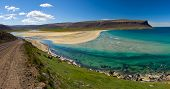 Extremely beautiful bay with mighty golden beaches and turquise sea in the West Fjords, Iceland. Pan