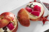 Apples Stuffed With Cream And Fruit On White Plate