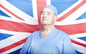 picture of british culture  - Portrait of a Senior Adult Surgeon in front of a British Flag - JPG