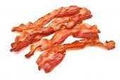 Cooked bacon rashers isolated on white.