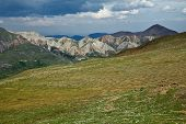 foto of denali national park  - Dark clouds loom over the fields and mountains of Alaska - JPG
