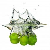 Splash made by plunging grape into a water
