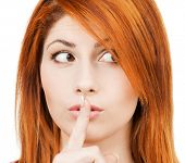 hush - mysterious woman with finger on her lips