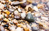 A close up view of smooth polished multicolored stones on the beach. Crimea, Ukraine, Europe. Beauty