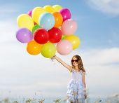 summer holidays, celebration, family, children and people concept - happy girl with colorful balloon