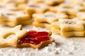 stock photo of christmas meal  - Homemade Christmas cookies star with strawberry jam - JPG