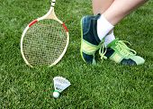 stock photo of badminton player  - foot of badminton player who stays on grass - JPG