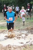 MUSKOGEE, OK - Sept. 14: Athletes run through mud and avoid zombies during the Castle Zombie Run at