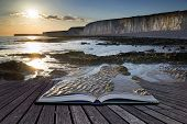 Creative Concept Pages Of Book Long Exposure Landscape Rocky Shoreline At Sunset
