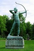 pic of garden sculpture  - Sanssouci garden sculpture of archer in Potsdam vertical - JPG