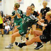 SIOFOK, HUNGARY - SEPTEMBER 14: Heidi Loke (green 5) in action at a Hungarian Championship handball