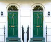 stock photo of front door  - symmetric photo of two front doors in typical london street  - JPG