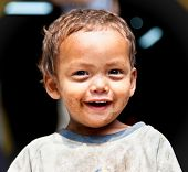 KATHMANDU, NEPAL - MAY 18: Portrait of an unidentified young smeared sherpa boy smiling on May 18, 2