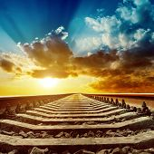 magic sunset over railroad to horizon