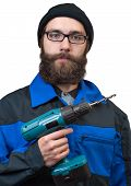 bearded man holding in a hand the electric drill