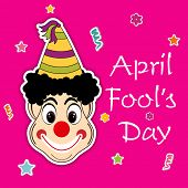 Happy Fool's Day funky concept with joker on pink abstract background.