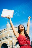 Successful Student Raising Arms