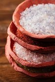 different type of salt in rustic clay bowls   stacked, Himalayan Pink Crystal Rock salt, Hawaiian Red Alaea Sea Salt, Persian Blue Iranian, Lemon Salt