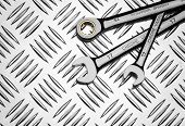 Set of wrenches on metal background, close up