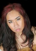 close-up of a pretty asian girl over a black background