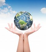 pic of longitude  - Hands with earth  - JPG