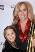 LOS ANGELES, CA - MARCH 6: Deb Wagner and her daughter arrive the Hollywood Comes Out to Salute to O