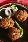 stock photo of kababs  - Kacche Kebab is made by Keema and besan adding egg. Roll the kababs holding the frying pan handle. Fry over moderate heat till kababs turn brown.Kacche kebab contains keema as major ingredient.