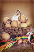Rural Braided Basket With Eggs And Sheep For Easter In Vintage Style