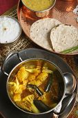 stock photo of brinjal  - Cauliflower Brinjal Curry is made with fresh vegetables and spices and served with rice and roti - JPG