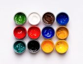 Colorful gouache paints on white background
