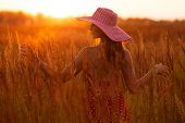 picture of beatitudes  - Happy woman in a hat of the high meadow grass