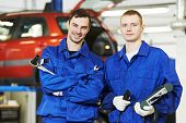 repairman mechanic workers at car engine auto repair shop service station