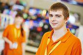 Positive team of shop assistants in supermarket store
