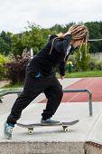 Teenage Girl Riding Her Skateboard