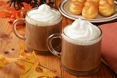 image of cream puff  - Cups of hot chocolate with whipped cream and cream puffs on a holiday table - JPG